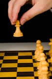 Hand holding pawn Stock Images