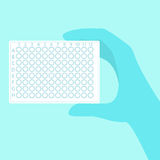 Hand holding pcr plate royalty free illustration