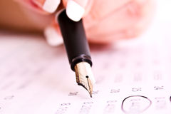 Hand holding a pen Royalty Free Stock Image