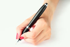 Hand holding a pen Stock Images