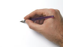 Hand Holding Pen. Hand holding artistic pen writing stock photos