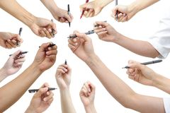 Hand holding pen. Many hand holding pen, with white background Royalty Free Stock Photo