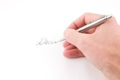 Hand holding pen. On white royalty free stock photos