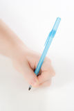 Hand holding a pen royalty free stock photography