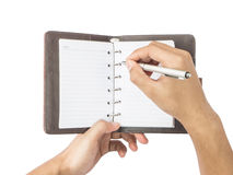 Hand holding pen with blank notepad Royalty Free Stock Photos