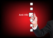 Hand holding pen choosing anti HIV Stock Photography