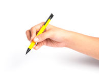 Hand holding a pen over white background Royalty Free Stock Photography