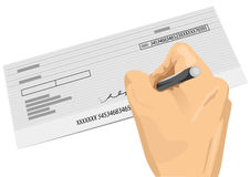 Hand holding a pen signing a blank check Royalty Free Stock Photo