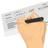 Hand holding a pen signing a blank check Royalty Free Stock Photos