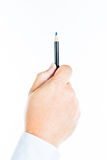 Hand is holding a pen Stock Image