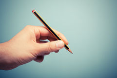 Hand holding pencil Royalty Free Stock Images