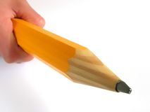 Hand holding pencil. In white background royalty free stock photo
