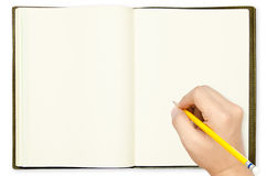 Hand holding pencil on blank note book Royalty Free Stock Photos