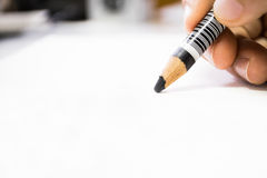 Hand holding pencil macro. Hand holding charcoal pencil closeup view stock images
