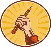Hand holding pencil sunburst. Illustration of a Hand holding pencil with sunburst set inside an oval Stock Photography