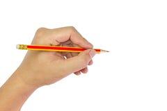 Hand holding pencil. Stock Photo