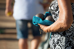 Hand of holding petanque ball. Close up of people at sport,seniors playing the french game petanque stock image