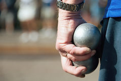 Hand of holding petanque ball. Fun and relaxing game stock photography
