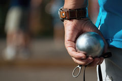 Hand of holding petanque ball. Fun and relaxing game royalty free stock photography