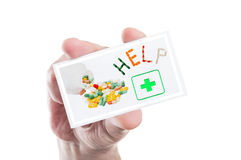 Hand holding pharmacy help or assistance card Royalty Free Stock Images