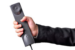 Hand holding phone. Businessperson in suit holding a phone handset Royalty Free Stock Photography