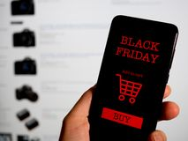Shopping online for black friday on phone. Concept royalty free stock image
