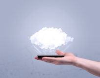 Hand holding phone with empty cloud Stock Photos