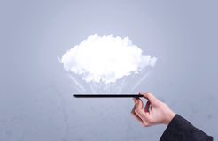 Hand holding phone with empty cloud Stock Photography