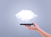 Hand holding phone with empty cloud Stock Image
