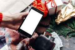 Hand holding phone with empty screen . seasonal sale. christmas Stock Image