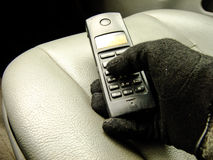 Hand holding Phone on the Front Seat Stock Photo