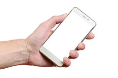 Hand holding a phone isolated on a white background located on the left Royalty Free Stock Photos
