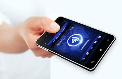 Hand holding phone with mobile payment connection Stock Photos