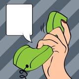 Hand holding a phone, pop art illustration Royalty Free Stock Photo