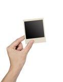 Hand holding photo frame isolated royalty free stock image
