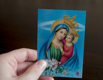 Hand holding picture of Mary and Jesus Royalty Free Stock Images