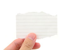 Hand holding a piece of blank notepaper Royalty Free Stock Images