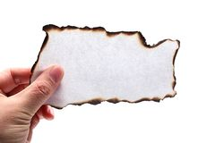 Free Hand Holding Piece Of Burned Paper Stock Photo - 28837800