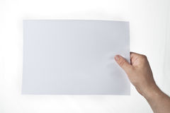 Hand holding piece of paper Royalty Free Stock Image