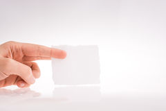 Hand holding a piece of paper Royalty Free Stock Photos
