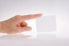 Hand holding a piece of paper Stock Photos