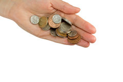 Hand is holding a pile of  British coins Stock Photography