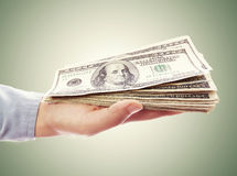 Hand Holding Pile of Cash Stock Images