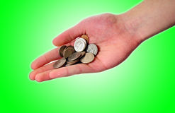 Hand holding pile of coins Royalty Free Stock Photography