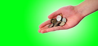 Hand holding pile of coins Stock Images