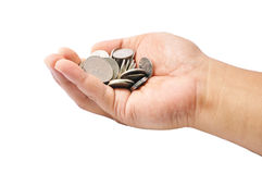Hand Holding A Pile Of Coins Over White Background Royalty Free Stock Photography