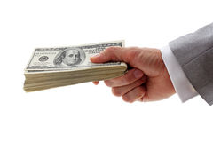 Hand holding pile of dollars. Hand of businessman holding pile of dollars Stock Photos