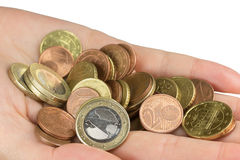 Hand is holding a pile of euro coins closeup Royalty Free Stock Photos