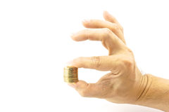 Hand holding pile of gold coin. Look like hand signals OK Stock Photography