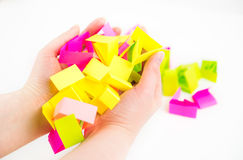 Hand holding pile of paper pieces Royalty Free Stock Photography